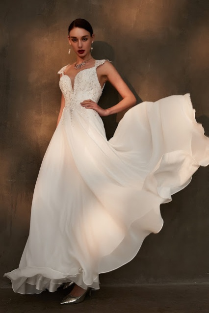 gorgeous A-line white wedding dress with beaded top