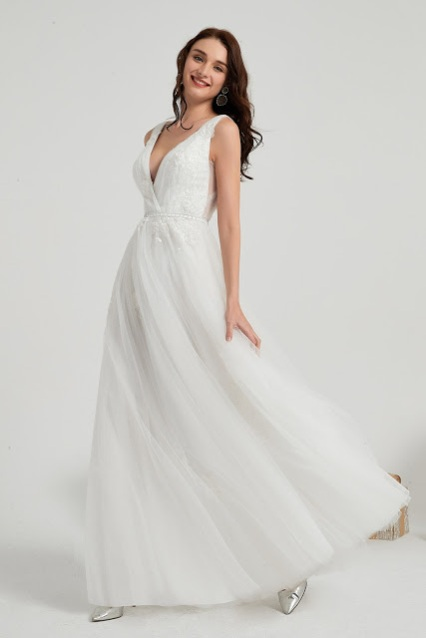 A-line sleeveless v neck white wedding gown