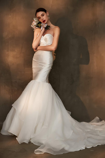 white strapless wedding dress with mermaid long tail